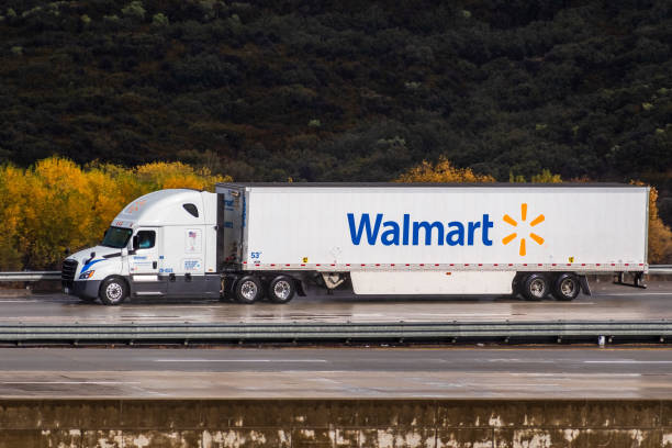 Walmart truck driving on the interstate Dec 8, 2019 Los Angeles / CA / USA - Walmart truck driving on the interstate, after the rain; wet asphalt visible wal mart stock pictures, royalty-free photos & images