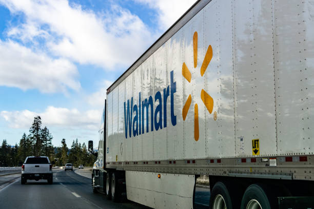 Walmart truck December 27, 2018 Truckee / CA / USA - Walmart truck driving on the interstate through the Sierra mountains wal mart stock pictures, royalty-free photos & images