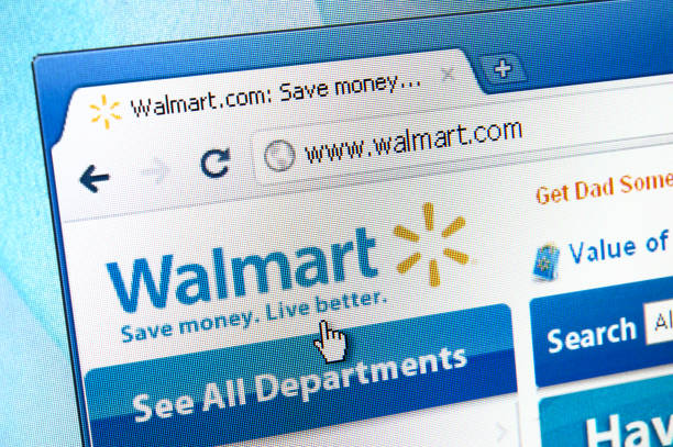 Walmart webpage on the browser Izmir, Turkey - June 01, 2011: Close up to the Walmart logo on web browser. Walmart is an American public multinational corporation that runs chains of large discount department stores and warehouse stores. wal mart stock pictures, royalty-free photos & images