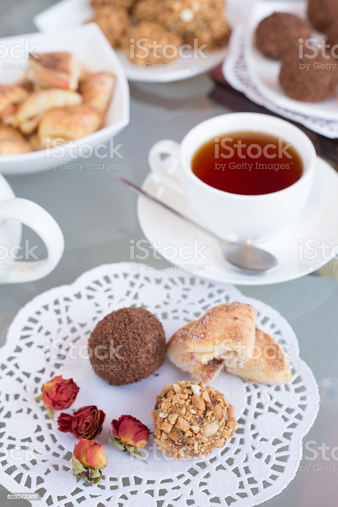 walnut balls, table with a cup of tea stock photo