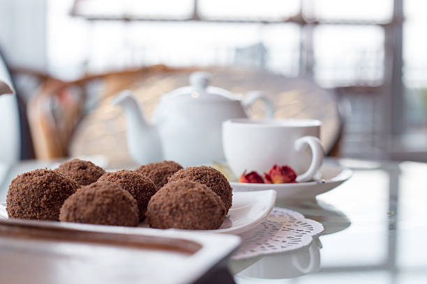 walnut balls, table with a cup of tea - kokoskuchen stock-fotos und bilder