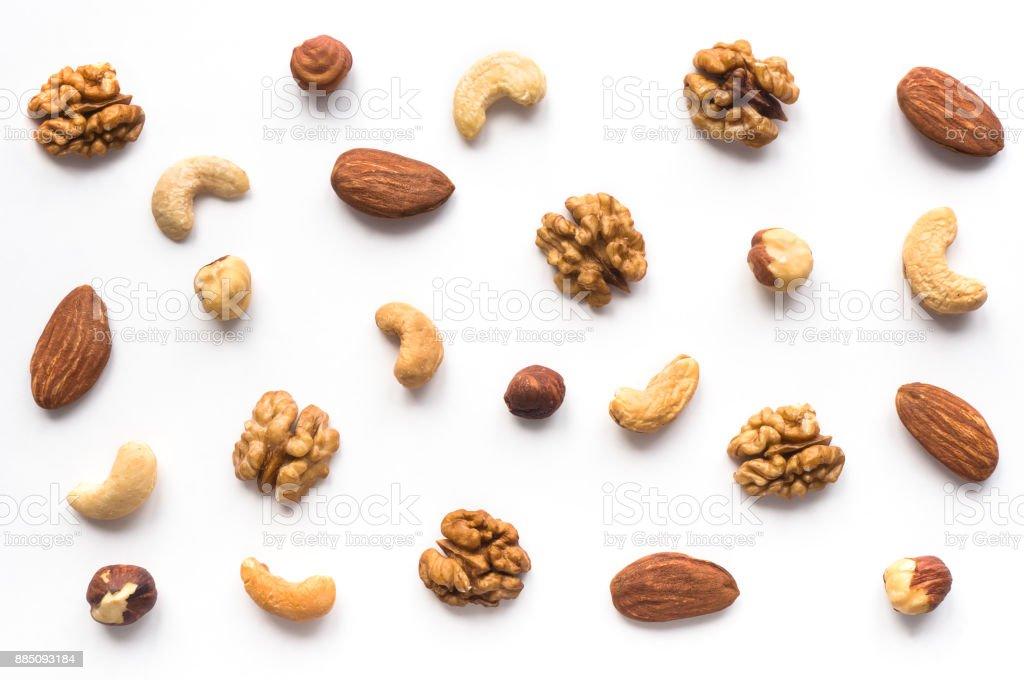 Walnut, cashew, almond and hazelnut on white background. - Zbiór zdjęć royalty-free (Białe tło)