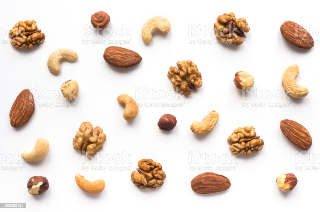 Walnut, cashew, almond and hazelnut on white background. stock photo