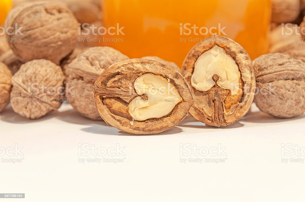 Walnut close on white table with honey jar royalty-free stock photo