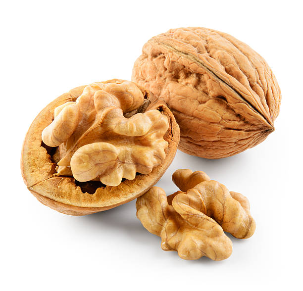 walnut isolated on white background. with clipping path. - 硬殼果 個照片及圖片檔