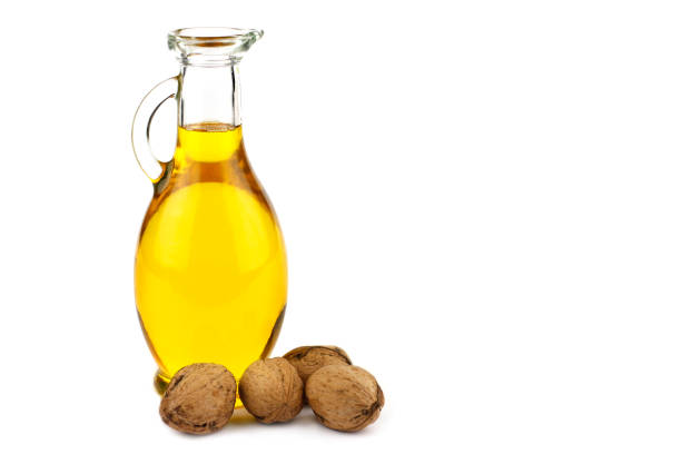 Walnut oil in bottle isolated on white background stock photo