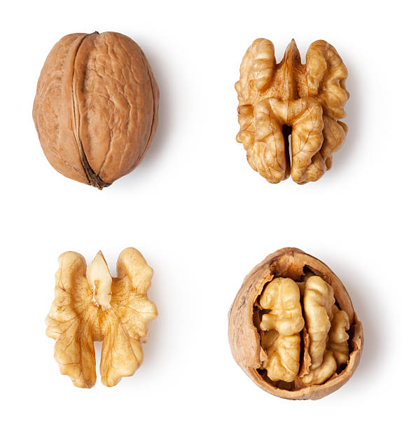 walnut walnut and a cracked walnut isolated on the white background walnut stock pictures, royalty-free photos & images