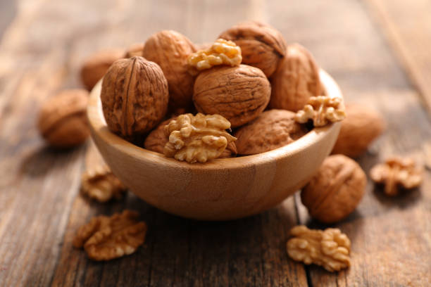 walnut - walnut stock photos and pictures