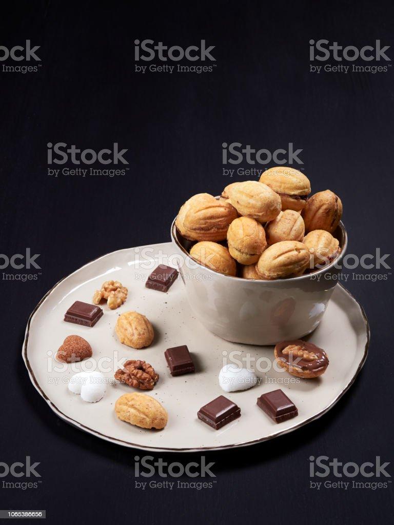 Walnut shaped cookies. Russian oreshki. stock photo