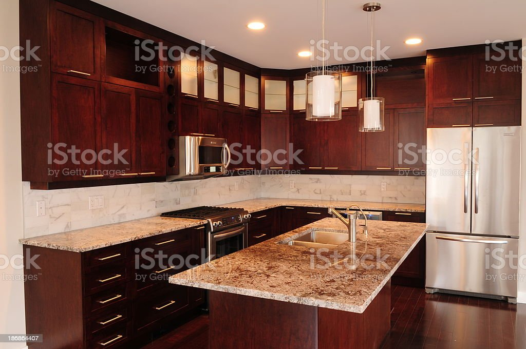 walnut kitchen cabinets granite countertops walnut stain on maple cabinets granite countertops stock 8902