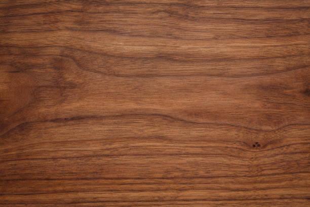 walnuss holzstruktur - nussbaumholz stock-fotos und bilder