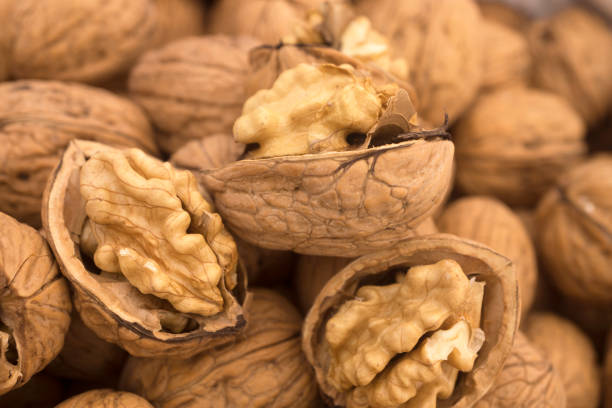Walnuts Background Walnuts Background walnut stock pictures, royalty-free photos & images