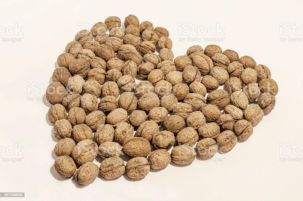 Walnuts heart shaped on white royalty-free stock photo