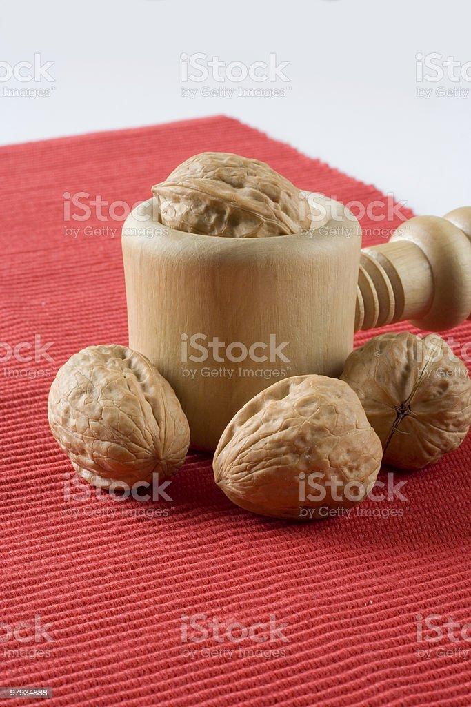 Walnuts in a nutcracker royalty-free stock photo