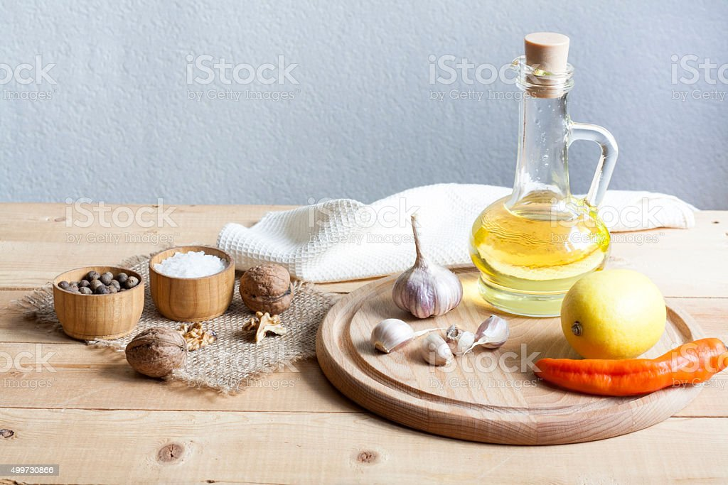 Walnuts in a white bowl, garlic, pepper salt and oil royalty-free stock photo
