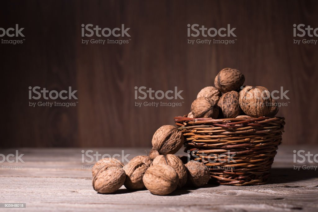 Walnuts in basket stock photo