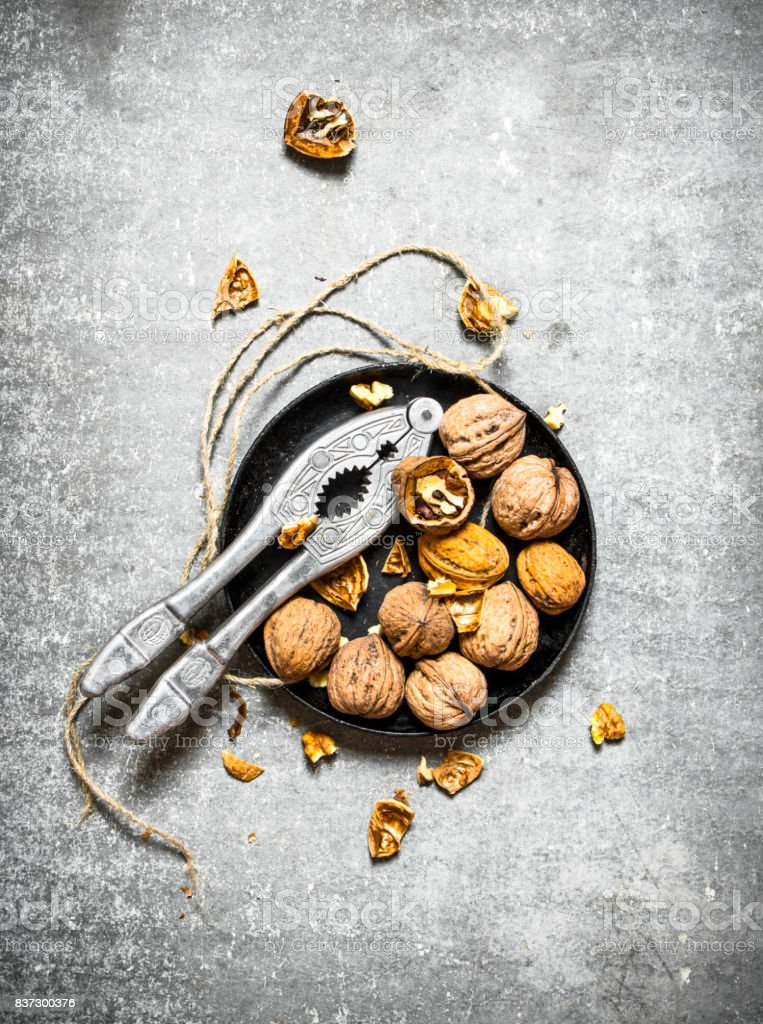 Walnuts in bowl with Nutcracker. stock photo