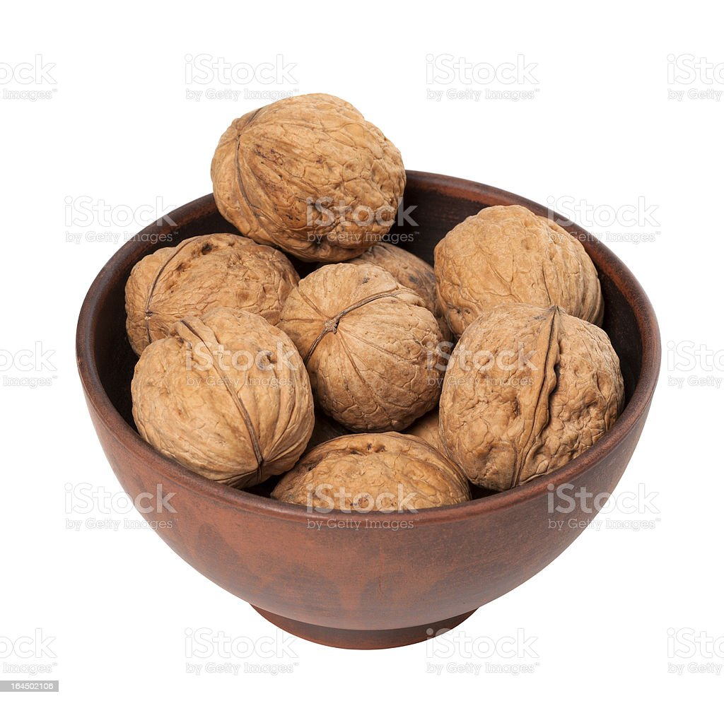 Walnuts in ceramic bowl royalty-free stock photo