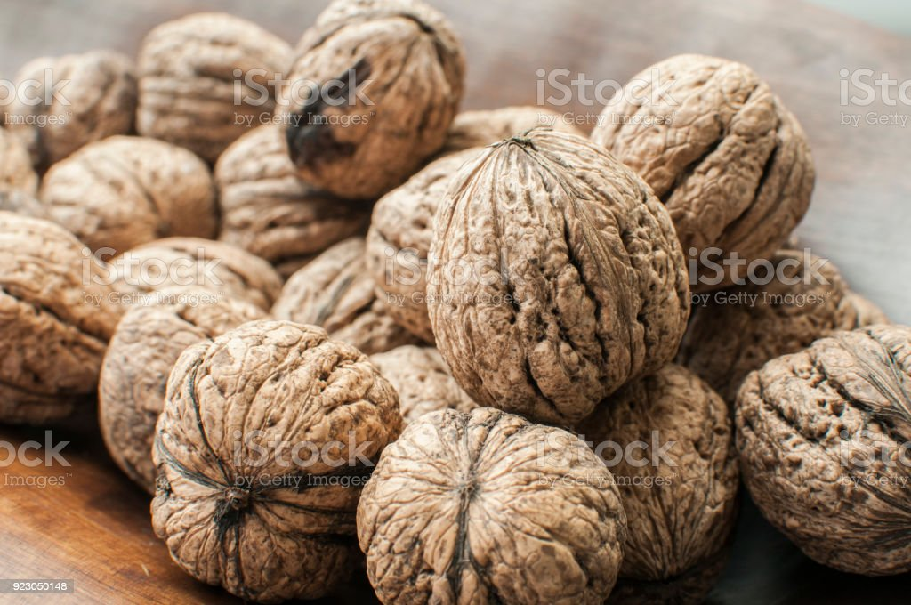 Walnuts in shell closeup stock photo