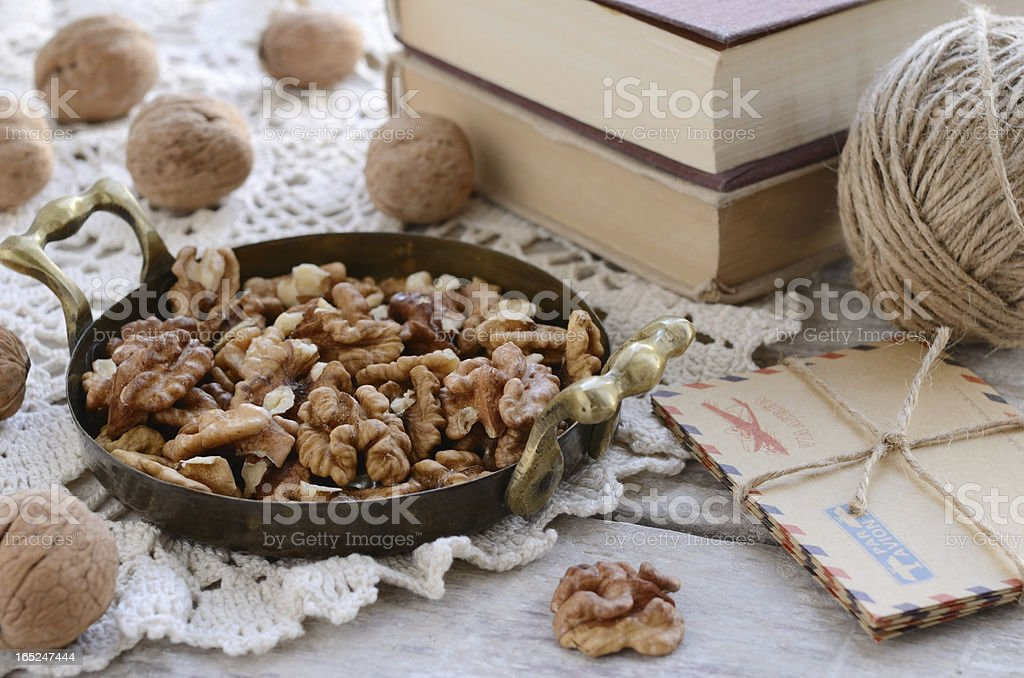 Walnuts in vintage tray on lace doily royalty-free stock photo
