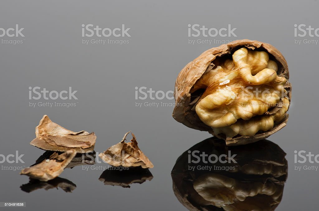 Walnuts isolated on black background. With reflection and copy space. stock photo