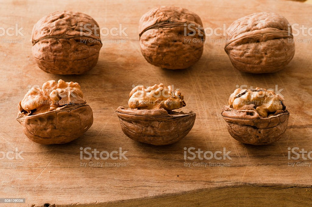 walnuts on a cutting board stock photo