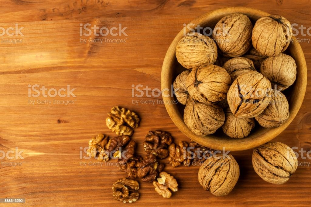 Walnuts on a wooden table. Healthy food. Sale of nuts. Advertising for walnuts. stock photo