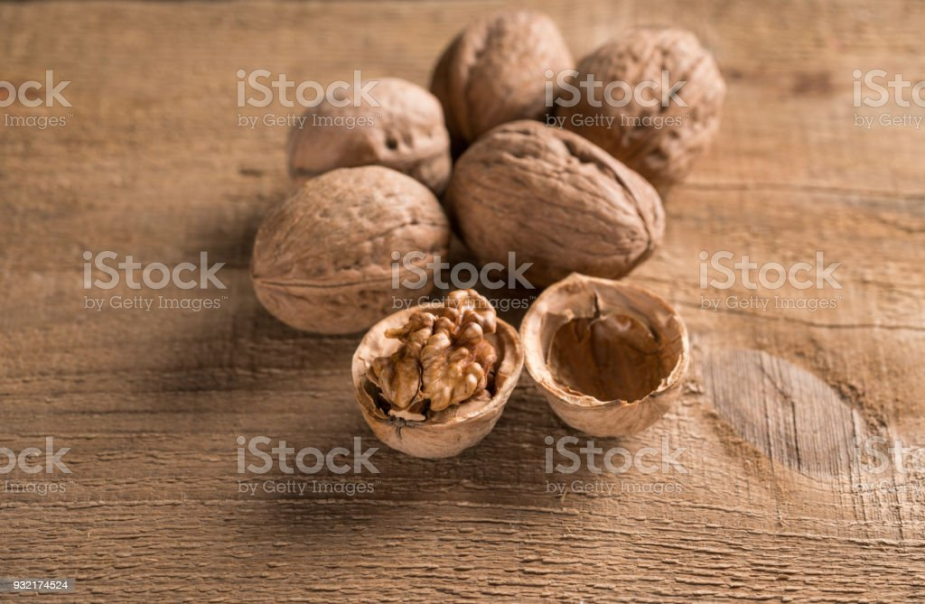 Walnuts on old wooden table stock photo