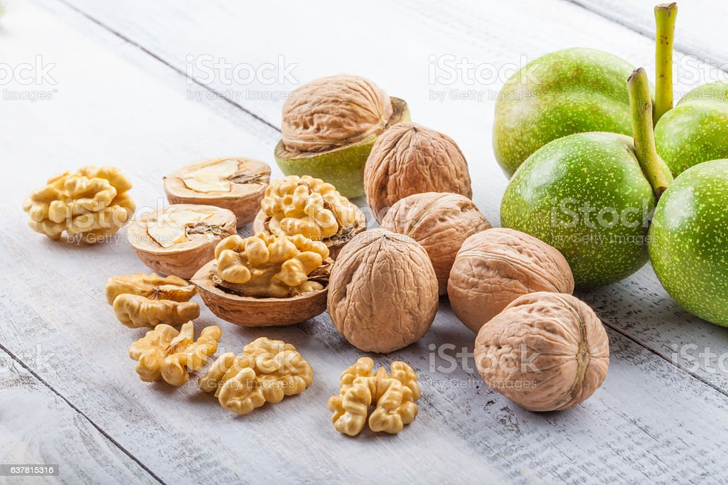 Walnuts on white table stock photo