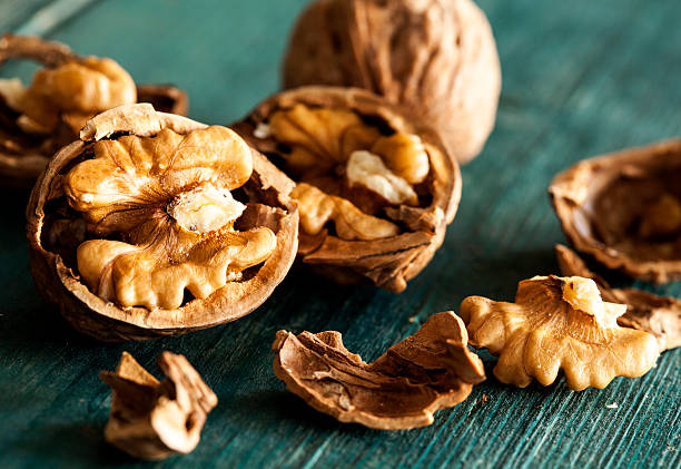 Walnuts on wooden table stock photo