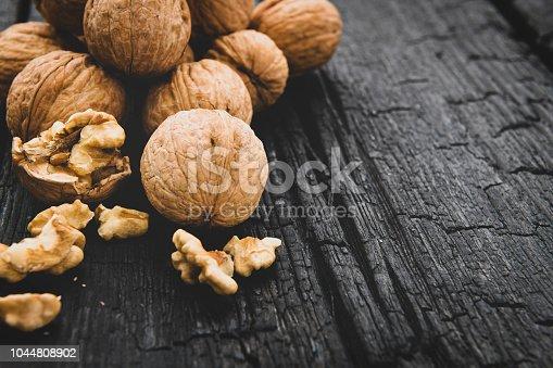 Walnuts on dark wooden background