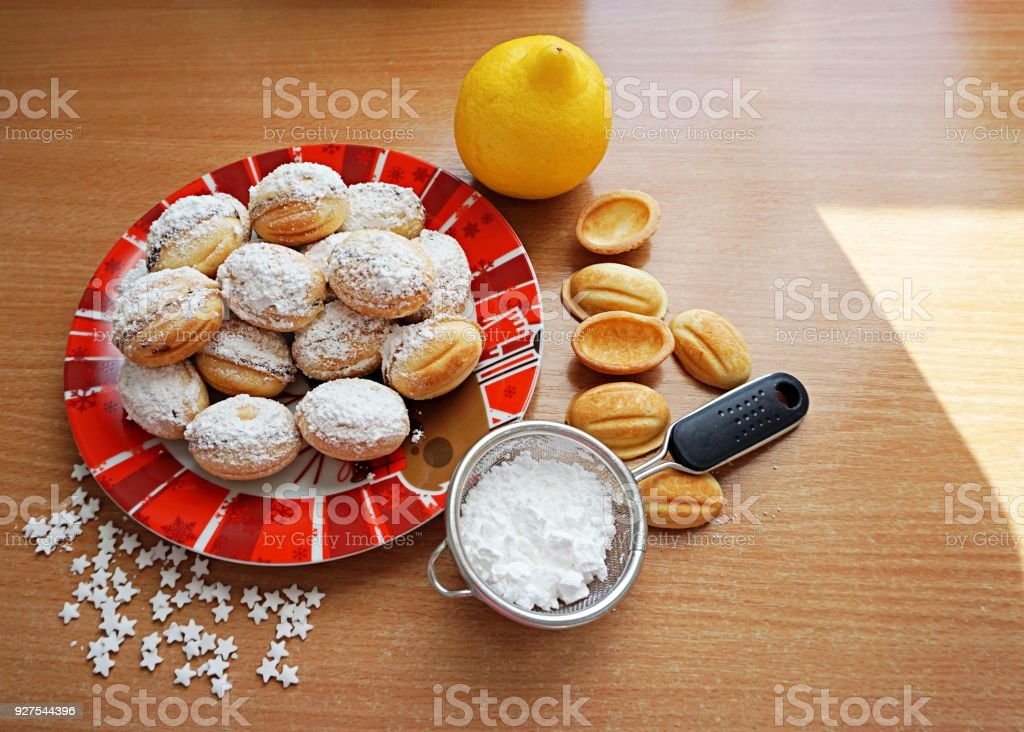Walnuts shaped cookies filled with chocolate stock photo