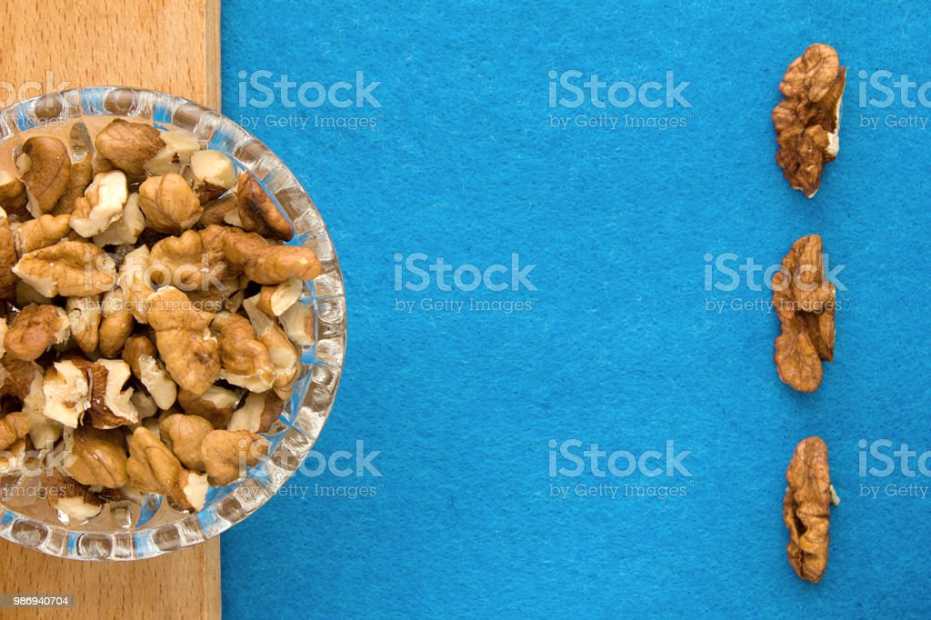 Walnuts Top View Of Wooden Board And Blue Background For Kitchen And Menu Stock Photo Download Image Now Istock