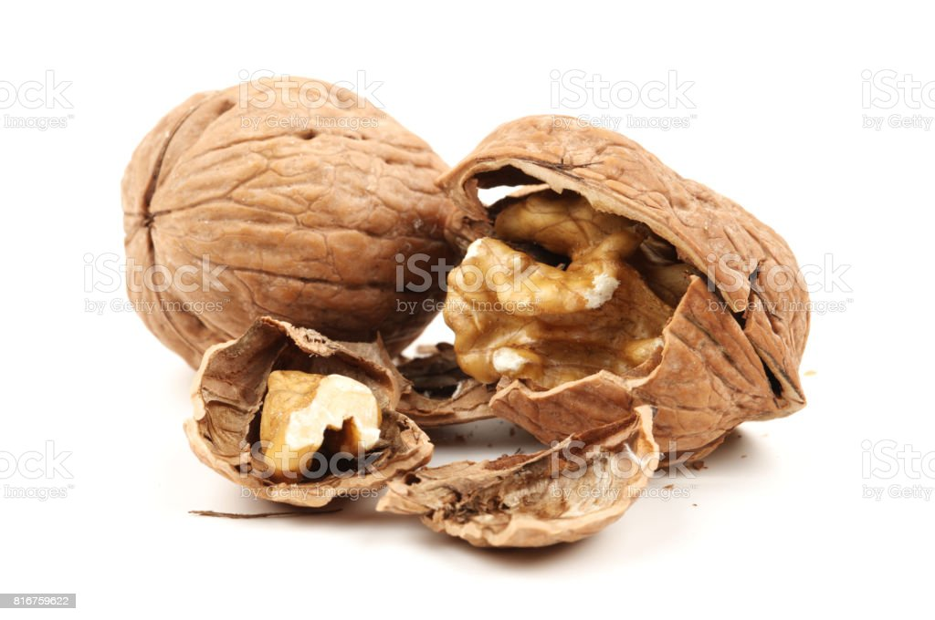 Walnuts with leaves isolated on white. With clipping path stock photo