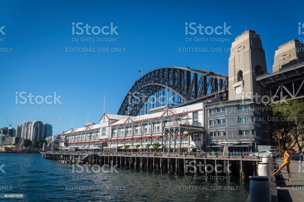 Walsh Bay development of luxury flats on the site of the old cargo bay warehouses and Harbour Bridge, Sydney, NSW, Australia stock photo