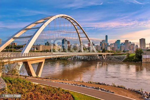 A scenic view of the iconic Walterdale Bridge and its walkway in Edmonton