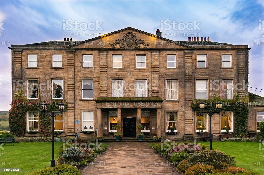 Walton Hall in a scenic setting of rolling parkland with stock photo