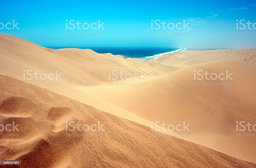 Walvis Bay sandscape to the sea, Namibia stock photo