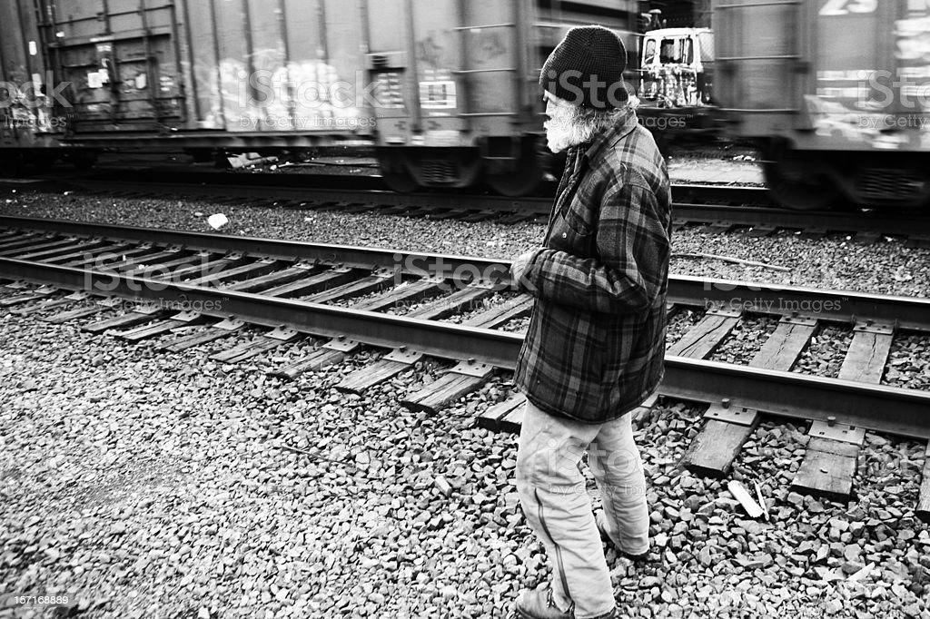 Wandering Man near Tracks. royalty-free stock photo