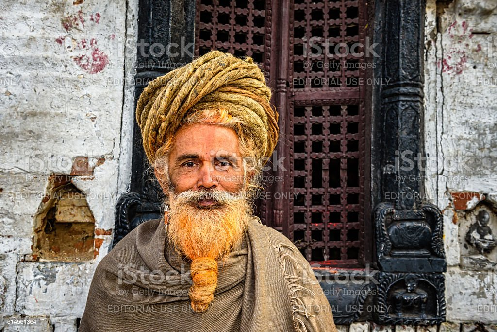 Wandering  sadhu baba (holy man) in ancient Pashupatinath Temple, Nepal stock photo