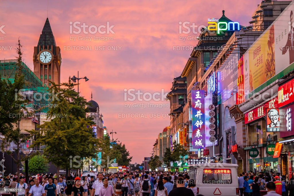 Wangfujing Dajie, the famous shopping street in Beijing at sunset stock photo