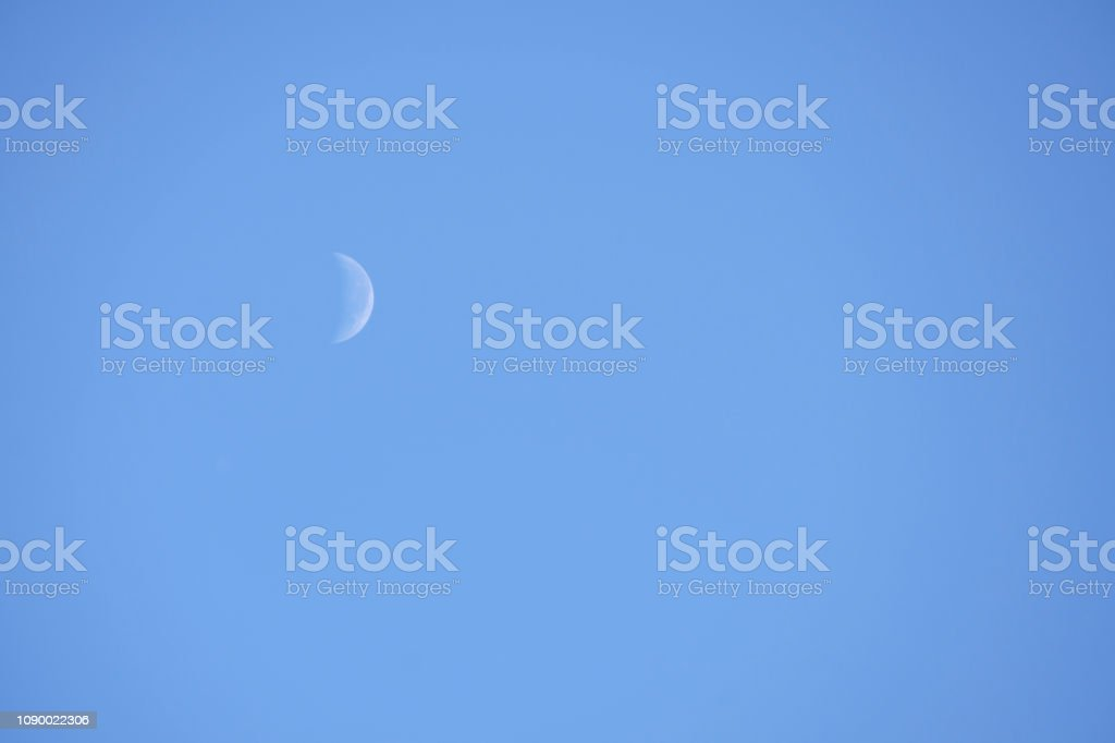 Waning Crescent Day. Lunar phase, bright illuminated moon during the...
