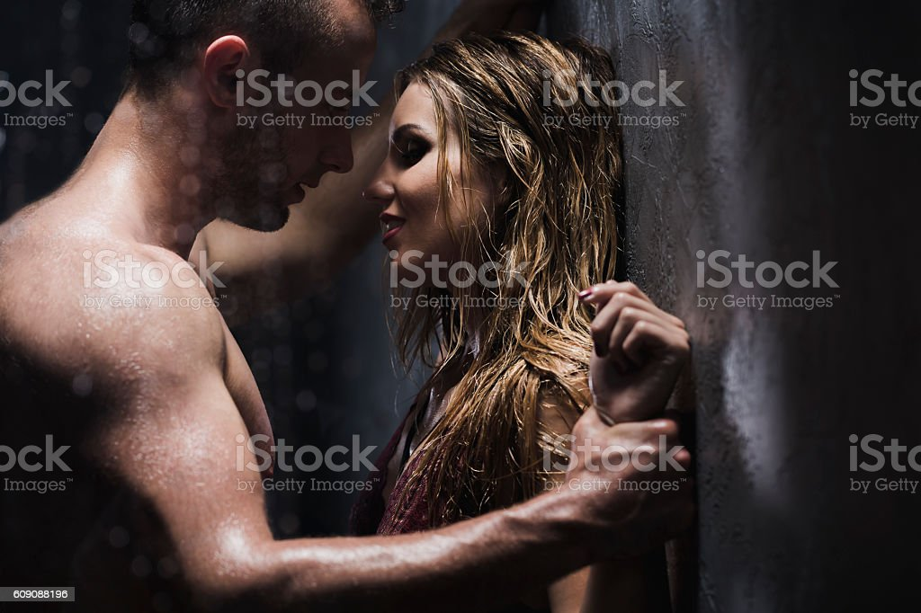 I wanna be yours... Beautiful young woman and her sexy boyfriend touching each other in the shower Adult Stock Photo