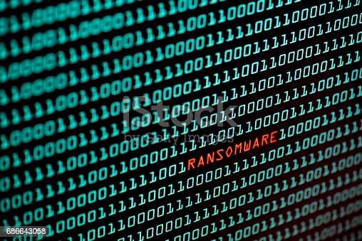 istock Wannacry text and binary code concept from the desktop screen. Wannacry or ransomware concept background, selective focus 686643058