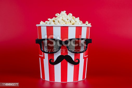 istock I want eat it all concept. Full length picture photo of looking like a human modern in black specs going on premiere watcher enjoying posters ads minimal style isolated vivid background copyspace 1169893277