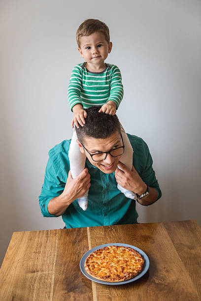 i want pizza too! - nerd boy eating stock photos and pictures