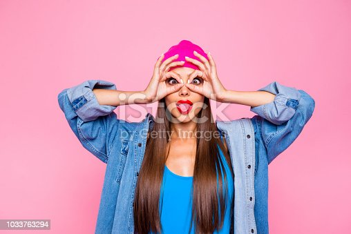 istock I want to be childish today! April fool's day! Emotion facial expressing concept. Close up photo portrait of playful beautiful pretty lady making eyeglasses with fingers isolated bright background 1033763294