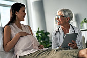 Cropped shot of a pregnant woman having a consultation with a female doctor