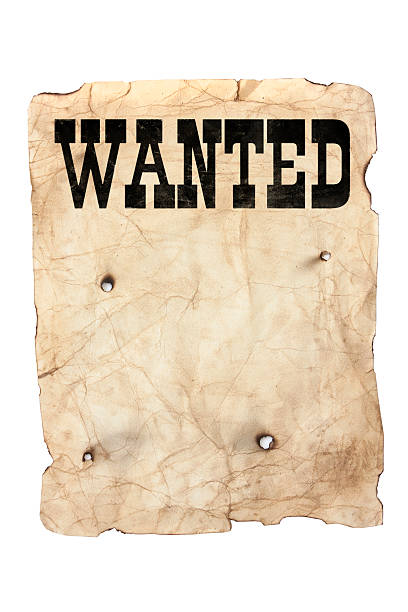 wanted poster and bullet holes stock photo