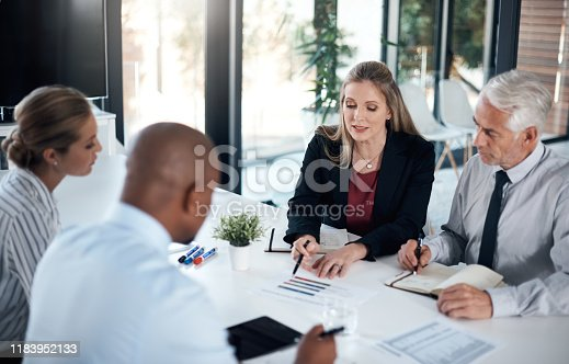 Shot of a group of businesspeople having a meeting in an office